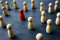 Uniqueness and differentness concept. Be unique. Wooden figures royalty free stock image