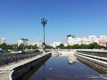 Unirii Boulevard in Bucharest and Parliament House. Background royalty free stock image