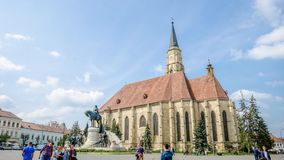 Unirii Square in Cluj-Napoca. Cluj-Napoca, Romania - 10 April: Timelapse in Uniri Square in the historic center with St Michael Church, Matei Corvin statue and stock footage