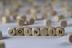 Unisca il cubo in- con le lettere, segno con i cubi di legno fotografia stock