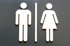 Unisex door symbol. Unisex symbols on a door sign. Even the gray color gives no hint of sexual preference Stock Photos