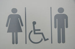 Unisex handicap bathroom sign Stock Photo