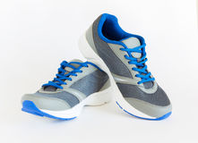 Unisex modern style jogging shoes. On white background Stock Photos