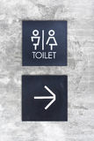 Unisex restroom or Toilet and arrow sign on  concrete wall style Royalty Free Stock Photography