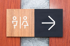 Unisex restroom or toilet and arrow sign on  wall style boutique Stock Photo