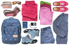 Unisex travel essentials including a passport filling the space on white background Royalty Free Stock Images