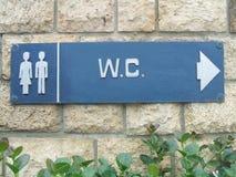 Unisexzeichen der öffentlichen Toilette W C Allgemeine Toiletten-Zeichen Stockbild