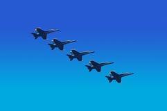 unisont blått flyg för änglar Arkivbilder