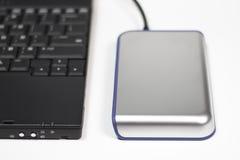 Unité de disque dur et ordinateur externes Photographie stock libre de droits