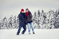 Unité de joie de neige de femme d'homme de couples Photographie stock