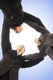 Unité de trois personnes d'affaires dans des vêtements formels Images stock