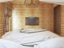 Unité de TV dans un intérieur moderne de chambre à coucher dans un rondin Photos libres de droits