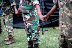 Unite Africa. South African soldiers holding hands. Mary coming together  in peace in troubled times Stock Image