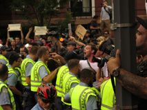 Counterprotesting Unite the Right 2. UNITE THE RIGHT 2018, DC, AUG. 12: A counterprotester points and yells at racist alt-right protesters who are marching in stock images