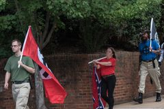 Unite The Right Rally 10:53 am. Charlottesville, Virginia USA August 12, 2017 Unite the Right demonstrators marching to Emancipation Lee Park for rally to gather stock photo