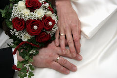 United. Just married couple, hands and flowers Royalty Free Stock Images