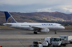 United Airlines, Airbus 219. United  Airlines, Airbus 219  airplane  taxiing to the gate at Salt Lake City International Airport Stock Photo