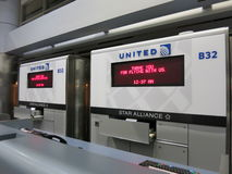 United Airlines Arrival Counter at Midnight -- late flight Stock Image