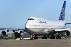 United Airlines Boeing 747 jet on tarmac. United Airlines Boeing 747 jumbo jet on the runway Stock Images