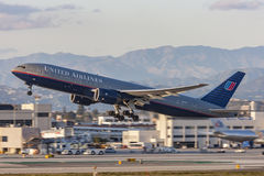 United Airlines Boeing 777 airplane taking off from Los Angeles International Airport. Royalty Free Stock Photography