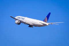 United Airlines Boeing 777. Boeing 777-200 of United Airlines climbing out after take off Royalty Free Stock Photography