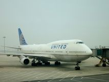 United Airlines Boeing 747. A Boeing 747 from the United Airlines fleet parked at the gate at an airport stock photography