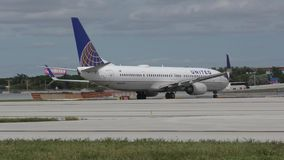 United Airlines Boeing 737 jet takeing off. Fort Lauderdale, USA - October 17, 2015: United Airlines Boeing 737 jet prepares for takeoff from Fort Lauderdale on stock video