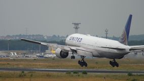 United Airlines Boeing 777 landing. FRANKFURT AM MAIN, GERMANY - JULY 20, 2017: United Airlines Boeing 777 N226UA landing at runway 25L, slow motion. Fraport stock video footage