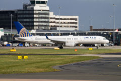United Airlines Boeing 757. Manchester, United Kingdom - February 16, 2014: United Airlines Boeing 757 in front of Manchester Airport Terminal royalty free stock photography