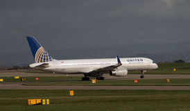 United Airlines Boeing 757. Manchester, United Kingdom - February 16, 2014: United Airlines Boeing 757 taxiing on Manchester Airport runway stock photo