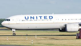 United Airlines doing taxi on the runway. United Airlines doing taxi on Munich Airport, MUC, Germany stock video footage