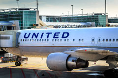 United Airlines jet at gate. United Airlines Boeing 767-300 parked at gate at Amsterdam Schiphol Airport Royalty Free Stock Image