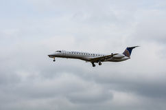 United Airlines Landing. United Airlines plane flying in cloudy day Stock Photography
