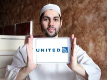 United airlines logo. Logo of united airlines on samsung tablet holded by arab muslim man Royalty Free Stock Image