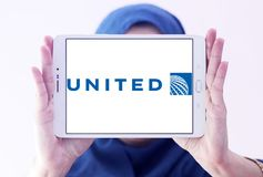 United airlines logo. Logo of united airlines on samsung tablet holded by arab muslim woman Royalty Free Stock Images