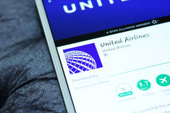 United airlines mobile app. Downloading united airlines mobile app from google play store on samsung tablet Stock Photography