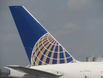 United airlines plane tail. The tail of a united airlines plane in Newark airport Stock Photos