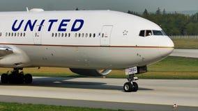 United Airlines plane taxiing in Frankfurt Airport, FRA. United Airlines airplane doing taxi on runway in Frankfurt Airport, FRA, Germany stock video