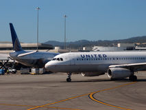 United Airlines Planes sit parked at Airport Royalty Free Stock Images