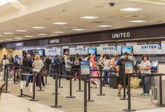 United Airlines Ticketing. A United Airlines ticket counter inside an airport terminal Stock Images