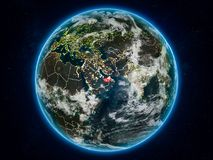 United Arab Emirates on Earth at night. United Arab Emirates from space on planet Earth at night with visible country borders. 3D illustration. Elements of this Royalty Free Illustration