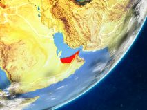 United Arab Emirates on Earth from space. United Arab Emirates on model of planet Earth with country borders and very detailed planet surface and clouds. 3D stock illustration