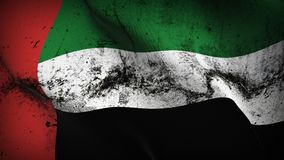 United Arab Emirates grunge dirty flag waving on wind. Emirati background fullscreen grease flag blowing on wind. Realistic filth fabric texture on windy day Royalty Free Stock Image