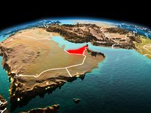 United Arab Emirates on planet Earth in space. Morning above United Arab Emirates highlighted in red on model of planet Earth in space with visible border lines Royalty Free Stock Images