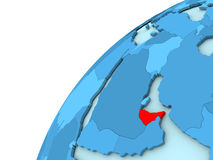 United Arab Emirates in red on blue globe Stock Photography