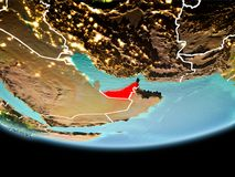 United Arab Emirates in red in the evening. Country of United Arab Emirates in red on planet Earth in the evening with visible border lines and city lights. 3D Royalty Free Stock Image