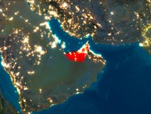 United Arab Emirates in red at night. Satellite night view of United Arab Emirates highlighted in red on planet Earth. 3D illustration. Elements of this image Royalty Free Stock Photo