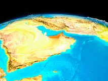 United Arab Emirates in red. Satellite view of United Arab Emirates highlighted in red on planet Earth with borderlines. 3D illustration. Elements of this image Royalty Free Stock Images
