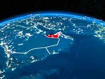 United Arab Emirates from space at night. Orbit view of United Arab Emirates highlighted in red with visible borderlines and city lights on planet Earth at night Royalty Free Stock Photo