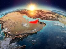 United Arab Emirates from space in sunrise. Satellite view of United Arab Emirates highlighted in red on planet Earth with clouds during sunrise. 3D illustration Stock Images